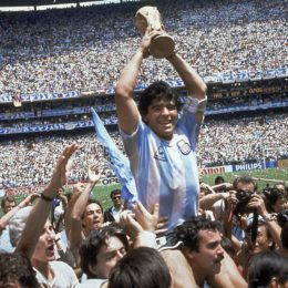 ** ADVANCE FOR WEEKEND EDITONS, MAY 29-30 **  FILE - In this June 29, 1986 file photo, Diego Maradona of Argentina, is lifted up as he holds the World Cup trophy after Argentina defeated West Germany 3-2 in the World Cup soccer final in the Atzeca Stadium, in Mexico City. (Ap Photo/Carlo Fumagalli, File)